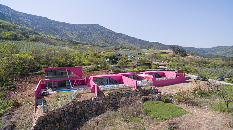 Moon Hoon creates four vibrant pink villas that overlook the Korean countryside