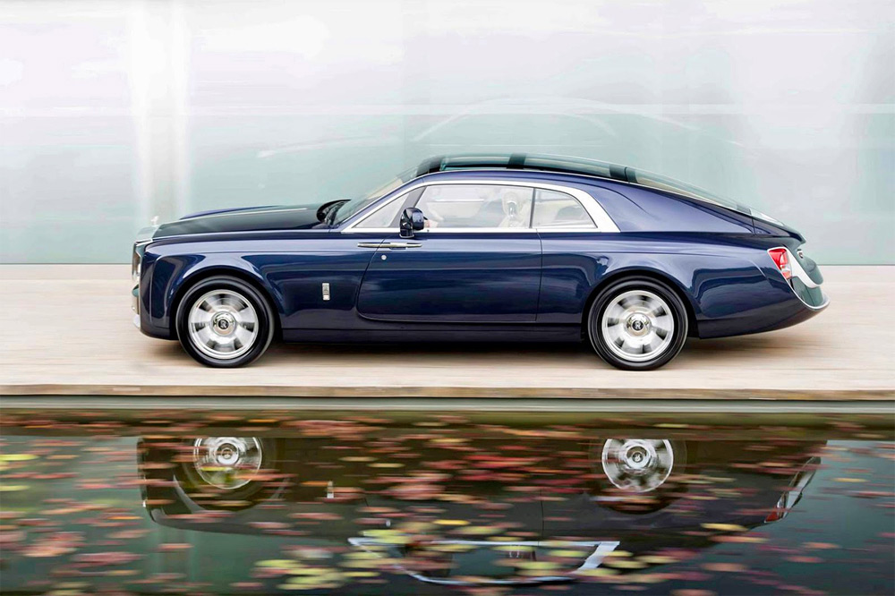 Rolls-Royce pays homage to the world of racing yachts for the clients desire a two seater throne on wheels with a large panoramic glass roof