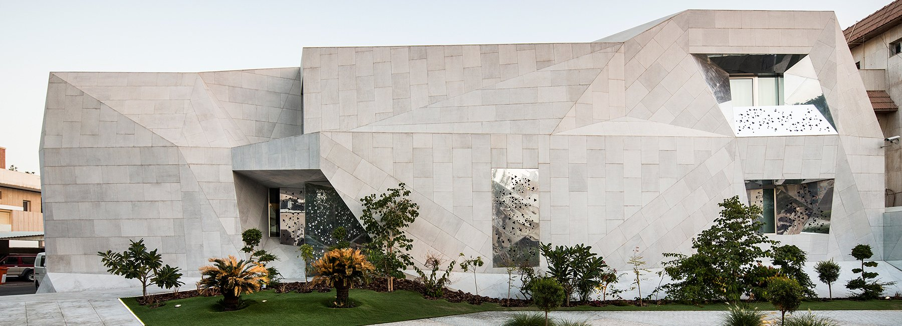 located in Kuwait city, 'rock house' by AGi architects is clad with reinforced concrete formed similarly to folded origami