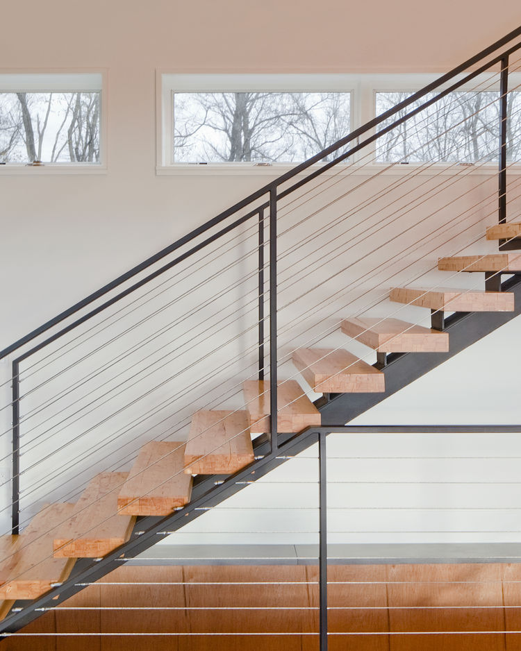 Stairs made from salvages laminated veneer lumber in Hudson Valley home.
