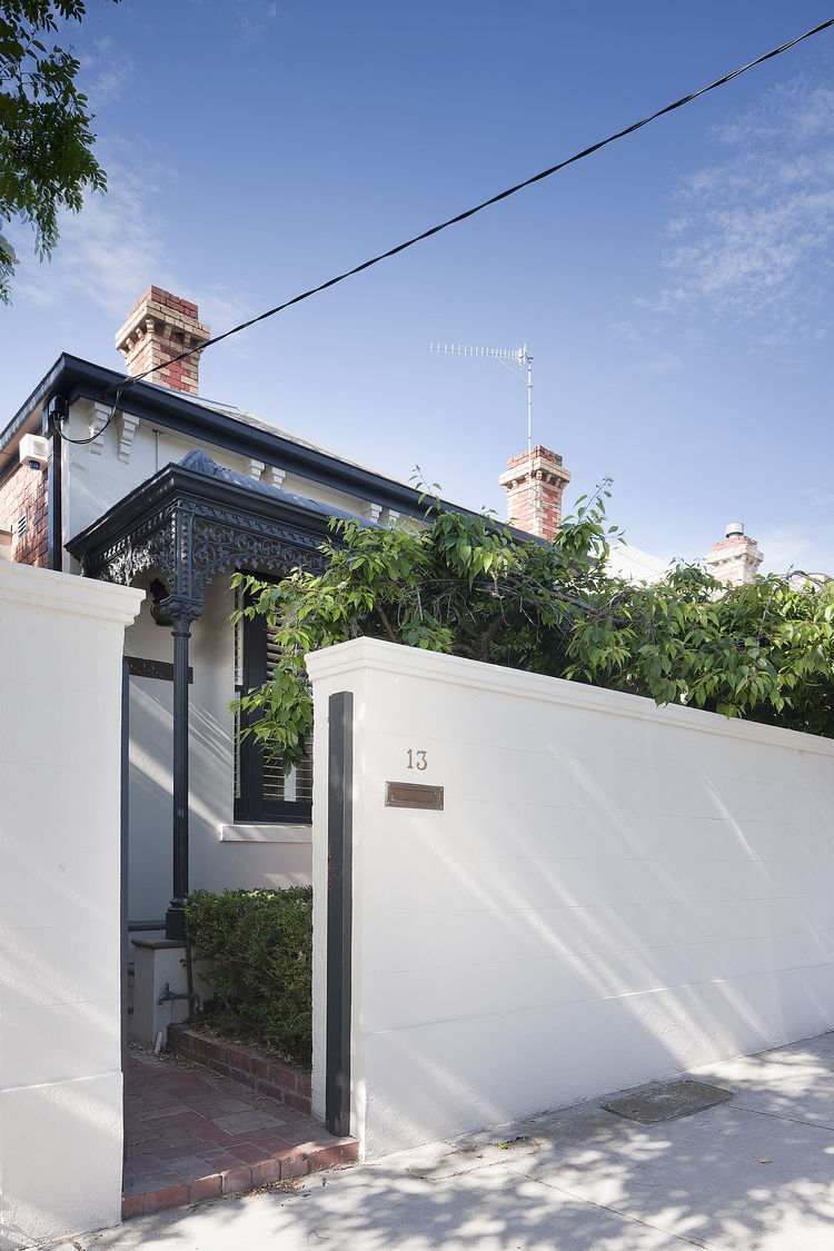 A Secluded Courtyard and Minimalist Interiors Hide Within This Victorian Renovation