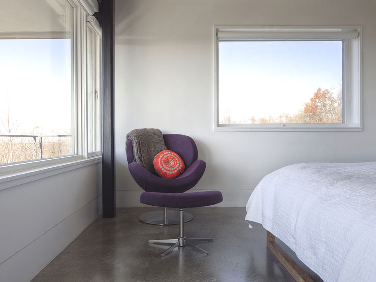 Schelly chair and ottoman from BoConcept in Hudson Valley home's master bedroom.