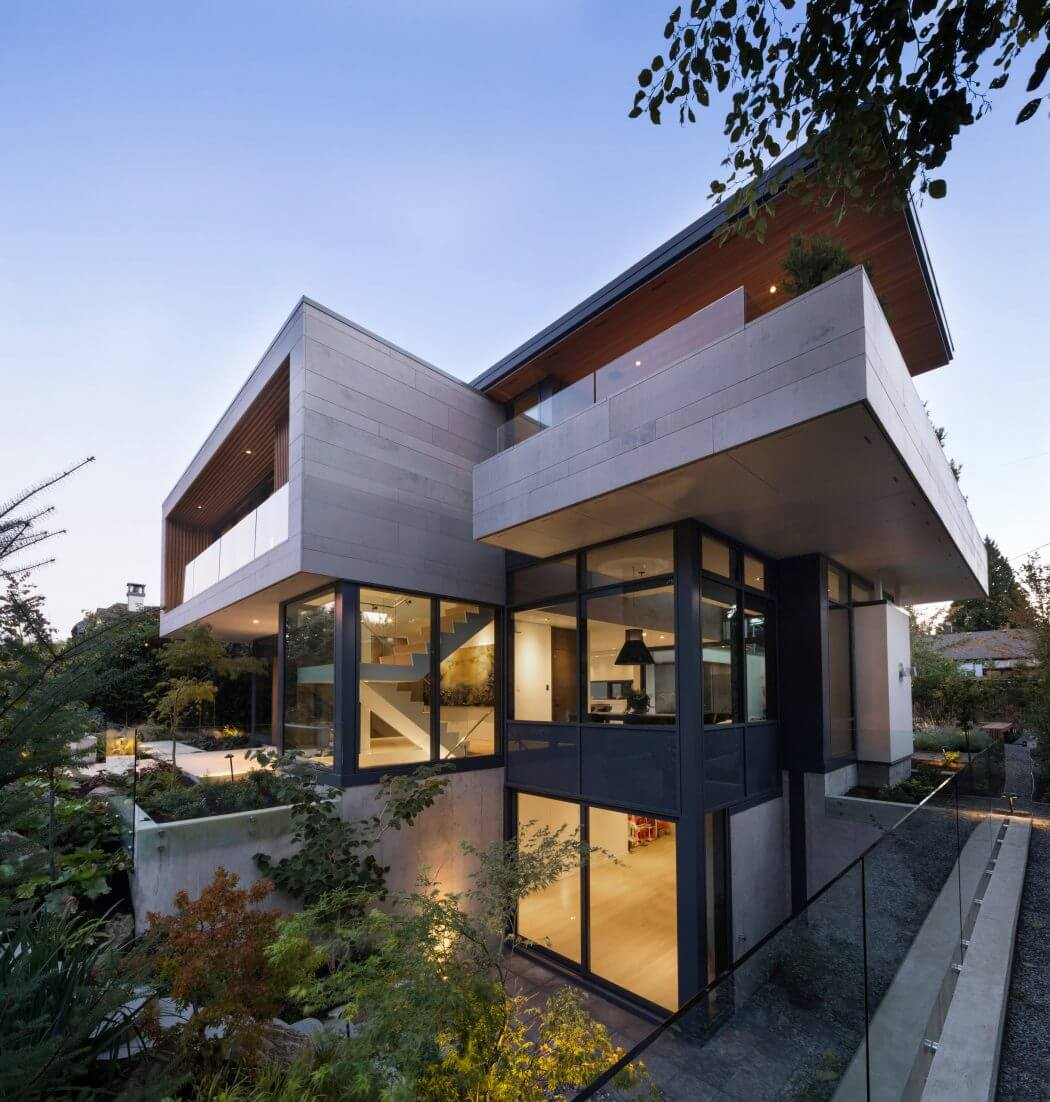Designed by Frits de Vries Architect, this contemporary two-storey home is located in Vancouver, Canada
