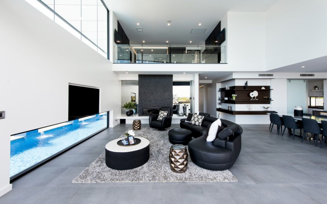 Designed by Robin Payne Building Design, this contemporary two-story residence is situated on Bribie Island, Australia
