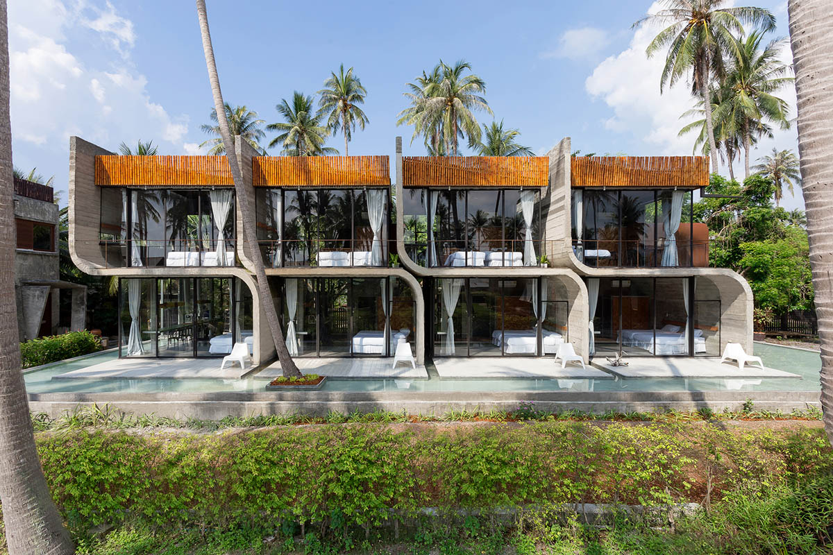 Thailand-based architecture firm NPDA Studio has built this two-storey house of s-shaped concrete elements that create walls and floors of the flats that are attached each other