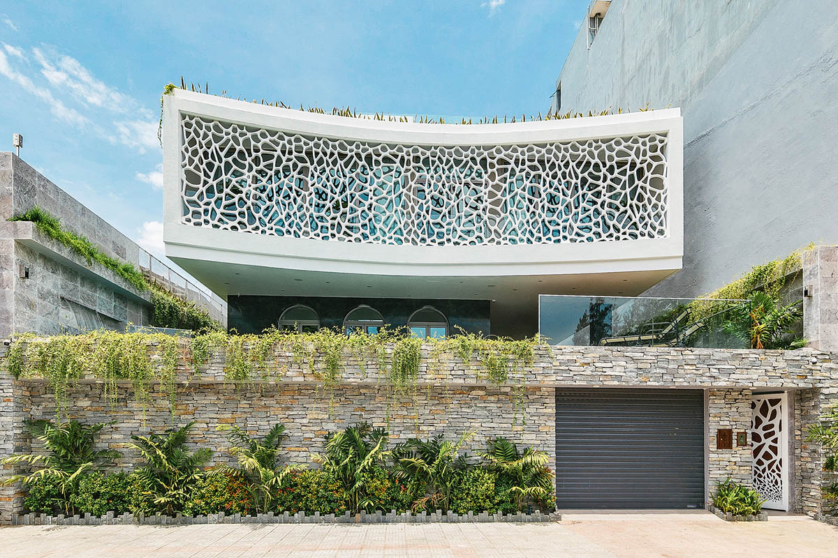 Coral-patterned facade for a family home in Vietnam