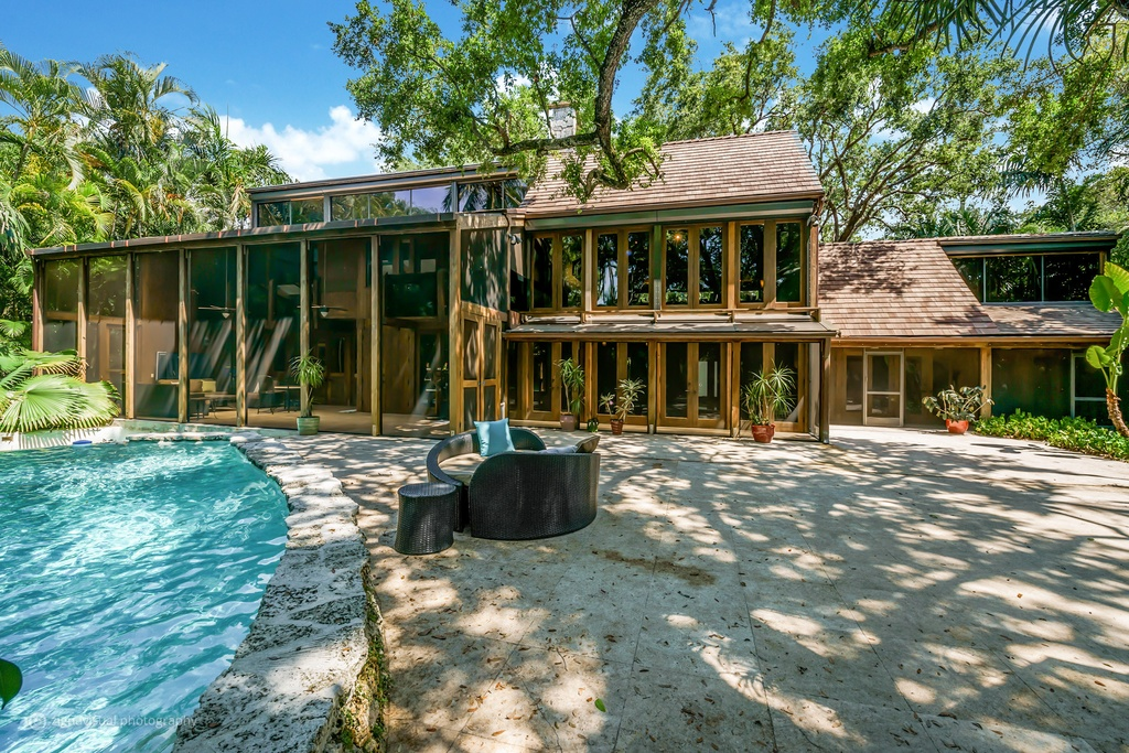 With a five-tiered cascading waterfall Listed yesterday for $4.22 million, here's aslick California-style contemporary in the heart of Coconut Grove on a large lot enveloped by botanical gardens