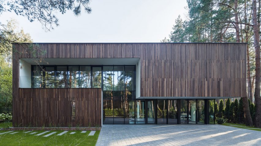 Smilgu House in Lithuania has a glass garage